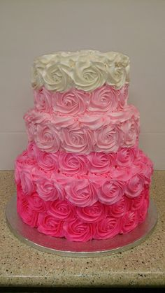 Ombre rosette 3 tiered stacked cake from white to a deep pink