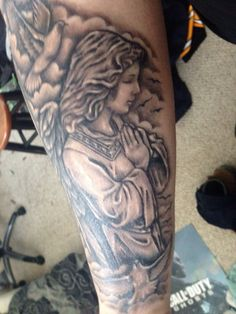Praying Angel with doves around her.   On my right forearm.