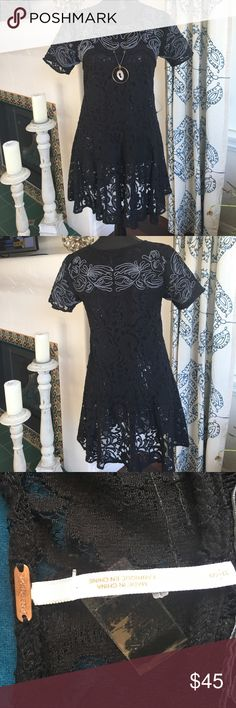 Free People lace dress in black and gray.  Size S. Free People black dress,  beautiful lace material with a gorgeous front design in gray!!  Size s.  Excellent condition Free People Dresses Mini
