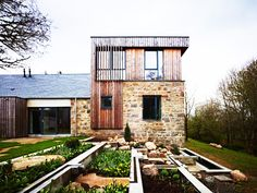 old mill conversion / brick wall / wood insertions / Dingwall, Scotland