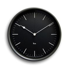 This sleek clock designed by an influential Japanese designer is a statement in monochromatic design. Mimicking the look of piano keys, it keeps time as regularly as a metronome. Made in Japan.