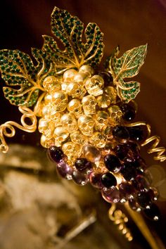 """Grapes of Immortality"" on display at the Dali house in Portligat. It consists of emeralds and amethysts set in gold with small diamond accents."