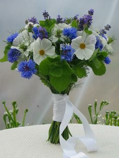 Handtied Bouquet made with White Cosmos aand Blue Cornflower and Mint, grown and made by Sussex Cutting Garden.