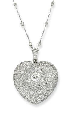 A BELLE ÉPOQUE DIAMOND HEART PENDANT -  Designed as a heart-shaped pendant centering upon an old European-cut diamond, within an old European-cut diamond surround, mounted in platinum and gold, circa 1910.
