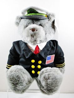 "Captain USA Stuffed Gray Teddy Bear. By Plush Creations. This plush animal is in excellent condition. Hand Crafted. Measures 18"" tall, color gray. ..... Visit all of our online locations..... www.stores.ebay.com/ourfamilygeneralstore ..... www.bonanza.com/booths/Family_General_Store ..... www.facebook.com/OurFamilyGeneralStore"