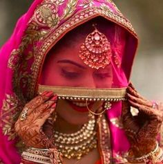 What a gorgeous #veil on this pretty bride .. #pink #ghunghat #net #gota #bride #punjabi