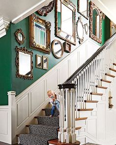Oh baby, do we love mirrors! Click the link in our bio to see more of this colorful #Detroit abode. Design by @coreydamenjenkins; : @wrsphoto #THGreatHomes #staircase #mirrormirror #liveincolor
