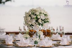 Exquisite table decorations of roses and white orchids and crystal beading