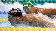 Michael Phelps of the United States leads Chad le Clos of South Africa in the Men's 200m Butterfly Final on Day 4 of the Rio 2016 Olympic Games