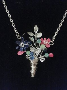 Bouquet of flowers necklace , made with beads, wire and nail polish.