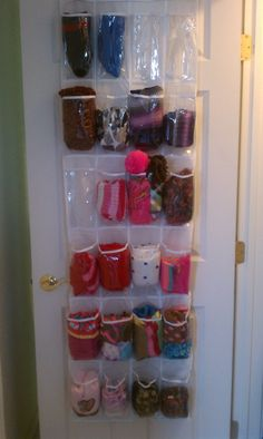 Shoe organizer $6.00 at Walmart used on inside of coat closet door to organize winter gear.
