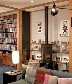 SLANTED AND ENCHANTED The main living area on the ground floor of this timber-framed home in Hackney, London has plenty of storage, bookc...