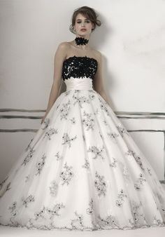 Ball Gown Strapless Dupioni Chapel wedding Dress...idk how much i like the bust area but i do find it very pretty