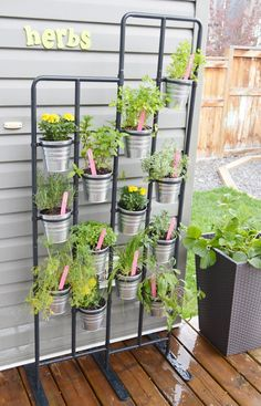 Herb Garden & 2 fun DIY Herb Marker Ideas- love this for small spaces!