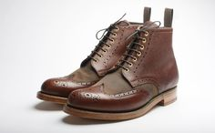 The Acklam is a full brogue derby boot that mixes Grenson leathers with Barbour waxed cotton, showcasing the heritage of both brands. The vamp is constructed from a rustic British Millerain waxed canvas, while the rest of the upper is a sturdy scotch grain leather. Internally the lining is a rich dark green calf leather. The upper sits on a double leather sole with a hand stained green welt.