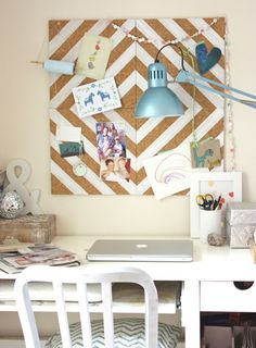 this chevron-inspired cork board is one of my FAVE ideas! you can do any color, you can do smaller boards (i like three across), or whatever you want! just use some duct tape and it's a great way to spruce up a boring cork board. Link not for board BTW ;)