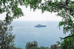 A photo of one of the huge yachts that sail from Nice to Cannes .
