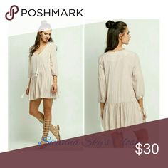 Gorgeous casual apricot mini dress This is such a gorgeous apricot v neck mini dress.  Perfect for this season!  Price is firm unless bundled! boutique Dresses Mini