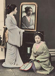 Two women.  Hand-colored photo,  1870's, Japan, by photographer Shinichi Suzuki.