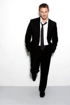 Another fine pic of Jessie Pavelka!  Sure looks like Mr. Grey in that suit!!