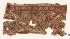 Textile fragment with lotus scroll. Cotton- Block printed with resist- 10th- early 11th century CE