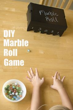Turn a shoe box into a marble roll game for kids #DIY