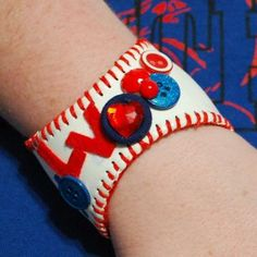 Baseball cuff bracelet how-to. I'm thinking a little bling would be cuter than primary colors.
