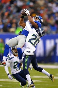 New York Giants wide receiver Victor Cruz (80) goes up for a catch as Seattle Seahawks cornerback Jeremy Lane (20) defends during the game between the Seattle Seahawks and the New York Giants at MetLife Stadium in East Rutherford, NJ