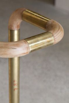 Brass and wood handrail by CODA Studio. Image: Peter Bennetts