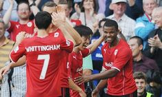Fraizer Campbell, right, celebrates scoring Cardiff City's second goal in the 3-2 defeat of Manchester City.