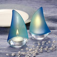 Illuminate your beach wedding or any nautical themed occasion with beautiful 3 x 5 glass blue Regatta sailboat votive candle holder favors with tea light candles.