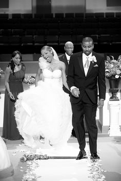 Northern Virginia wedding photographer Hennessey G sends in our first photo of jumping the broom. The contrast between the faces of the bride and groom makes this shot.