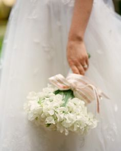 This bride carried a giant cluster of fragrant white sweetpeas tied with a 1940s ribbon