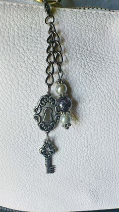 Beaded purse charm / handmade purse by CharmsAnTreasures on Etsy, $9.00 - like the simple design with gunmetal chain and just a couple of charms and beads