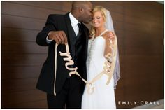 Bride & groom with mr & mrs sign