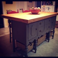 Custom  kitchen Island handcrafted from an antique buffet by my husband for my anniversary present. Love that guy!