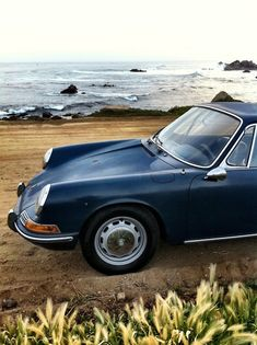 black Porsche by the sea