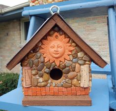 Sunny Side Cedar birdhouse with stones and river rock collected from the shores of Lake Michigan, local rivers and from creek beds and recycled embellishments of terra cotta sun, wine bottle corks and mini glazed terra cotta tiles. Base and roof line are weather proof stained in a medium brown color to enhance the other embellishments. The roof also sports a embossed copper tin look. Copper roof tile example HERE. Suitable for outdoor or indoor décor. Removable base for easy clean out.   9…