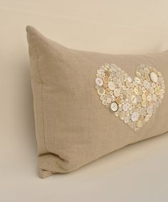two of my favorite things! burlap and buttons on a pillow. how PRETTY!