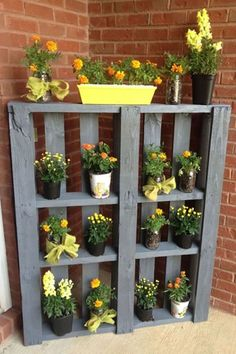 Pallet Flower Display:  Paint an old pallet and show off your favorite flowers near your front door or in a corner of your garden. The vertical display takes up very little space, and you can change out the flowers or decor with each season to keep things fresh!