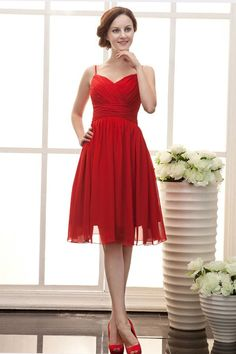 Description: Chiffon red dress in knee length, spaghetti straps and V neckline, the bodice is cross ruched. A-line silhouette and zipper back closure. Fabric: Chiffon Silhouette: A-line Color Shown: RedStrap: Spaghetti straps Sleeves: Sleeveless  Neckline: V necklineEmbellishment: Ruffles <…