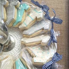 Cookies are always welcome—especially ones you didn't have to make! Treat your friends and family to an edible favor. Erin of Elements of Style packaged adorable blue and gray onesie cookies for guests at her shower. Personalize with a monogram of your baby's initials and top with a cute bow.