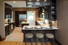 Urban Kitchen- Small space but big design. Very clean and contemporary. #kitchen #design