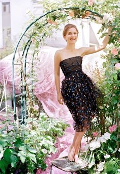 Natalie Portman in a garden with a Dior dress and flowers