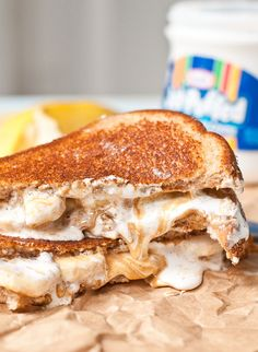 A childhood favorite goes gourmet with these melty Grilled Banana Fluffernutter Sandwiches. Snack Recipes, Cooking Recipes, Snacks, Just Desserts, Delicious Desserts, Grilled Bananas, Good Food, Yummy Food, Soup And Sandwich