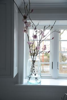 barely blue jar, blooming tree branches, simple, clean, lovely!