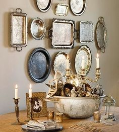 I'm so *not* a fancy girl, but I absolutely love displays of silver trays...