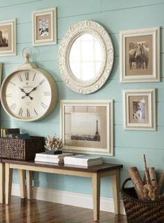 blue living room - art arrangement with large clock