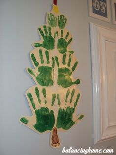 Family Hand Print Christmas Tree OR one kid's handprints every year - tree just keeps getting bigger. Noel Christmas, Family Christmas, All Things Christmas, Winter Christmas, Christmas Gifts, Christmas Activities, Christmas Crafts For Kids, Holiday Crafts, Holiday Fun
