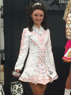 White Irish dance dress, very pretty and delicate colors for a solo. White looks great with dark hair!
